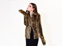 Leopard fur at stylish girl. Look of fashion model with bad taste. Fur coat boutique with natural and artificial. Material. Woman in leopard fur coat isolated royalty free stock image