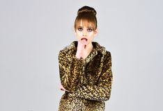 Leopard fur at stylish girl. Winter fashion and beauty. Look of fashion model with bad taste. Fur coat boutique with Royalty Free Stock Images