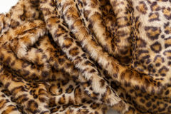 Leopard fur textile. The folds of the leopard fur textile close up Royalty Free Stock Photo