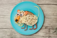 Leopard made with black bread, cheese and vegetables. On plate and board royalty free stock images