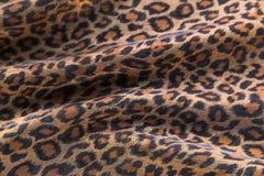 Leopard pattern background. Leopard pattern folded fabric background Stock Image