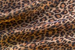 Leopard pattern background. Leopard pattern folded fabric background Stock Photos