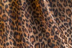 Leopard pattern background. Leopard pattern folded fabric background Royalty Free Stock Photo