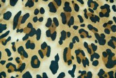 Leopard pattern silk. Texture, background Royalty Free Stock Photo