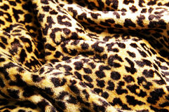 Leopard print. Closeup of a leopard pattern fabric royalty free stock images