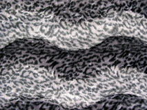 Leopard print background. Leopard print fabric background, in gray tones royalty free stock images