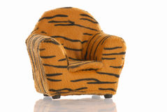 Leopard print chair. With reflection on white background stock images