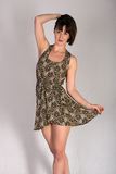 Leopard print dress. Statuesque young brunette in a leopard print dress royalty free stock photos