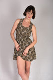 Leopard print dress. Statuesque young brunette in a leopard print dress stock photos