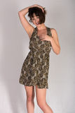 Leopard print dress. Statuesque young brunette in a leopard print dress royalty free stock photo