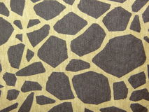 Leopard print fabric. Cotton fabric with leopard print in brown tones stock images