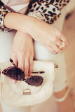 Leopard print and glasses in the hand Stock Photo