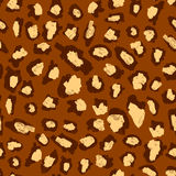 Leopard print pattern. Yellow-brown spots on a brown background. Leopard print pattern. Yellow-brown spots on a brown background Royalty Free Stock Photos