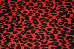 Leopard print red on fabric. Pattern stock photos