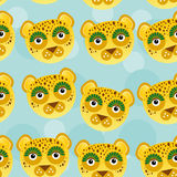 Leopard Seamless pattern with funny cute animal face on a blue b Royalty Free Stock Image