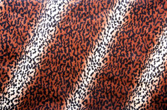 Leopard Skin Pattern on Faux Fur Fabric Royalty Free Stock Photo