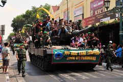 Leopard Tanks full of civilians, Yogyakarta city. Yogyakarta, Indonesia - 11 October 2014:  258th city anniversary - German Leopard 2 tanks are chock full with Royalty Free Stock Photography