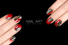 Leopard and Tiger Nail Art. Nail Polish Stickers w. Leopard and Tiger Nail Art. Fashionable nail polish with animal print stickers. Professional manicure and Royalty Free Stock Photo