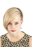 Leopard woman piercing look. Young woman with leopard costume and piercing look Stock Image