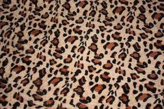 Leopardmuster auf Gewebedecke stockbild