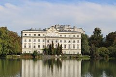 Leopoldskron Palace in Salzburg, Austria, Europe, with fortress Hohensalzburg in the background. Royalty Free Stock Images