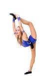 Leotardo azul que se resuelve, baile del bailarín del gimnasta que lleva del adolescente hermoso del atleta, haciendo ejercicio A Foto de archivo libre de regalías