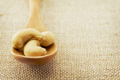 Lepel cashewnoten Stock Foto