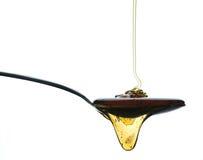 Lepel met honing Royalty-vrije Stock Afbeelding