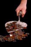 Lepel met muntstukken stock afbeeldingen