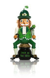 Leprechaun. A leprechaun figure sitting on a pot of gold for Saint Patrick's Day Royalty Free Stock Images