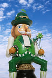 Leprechaun. A leprechaun figure sitting on a pot of gold for Saint Patrick's Day Stock Images