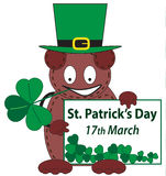 Leprechaun bear holding the announcement of Saint Patricks Day Stock Photos