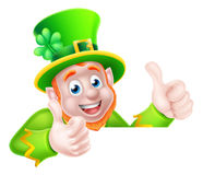 Leprechaun Cartoon. Character peeking above a sign and giving a double thumbs up Royalty Free Stock Image