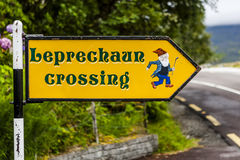 Leprechaun crossing sign in Killarney National Park, Ireland. Killarney National Park, County Kerry, Ireland - August 19, 2010: A Leprechaun is a type of fairy Stock Photo