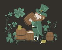 Leprechaun drinks beer from a wooden barrel Stock Photos
