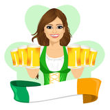 Leprechaun girl with beer mugs and irish ribbon, St. Patrick's Day concept Royalty Free Stock Photography