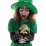 Leprechaun girl with a gold treasure in her Hands, isolated on w Stock Images