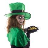 Leprechaun girl holding a gold treasure, concept st. patrick´s stock image