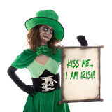 Leprechaun girl holding a scoll with text Kiss me i am irish, is Royalty Free Stock Photo