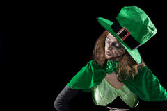 Leprechaun girl looking to copyspace, black background, concept Royalty Free Stock Images