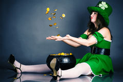 Leprechaun gold coin throws up Stock Photo