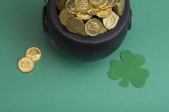 Leprechaun gold for st. patricks day. St. patty day background of leprechaun gold and shamrock Royalty Free Stock Photos