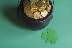 Leprechaun gold for st. patricks day. St. patty day background of leprechaun gold and shamrock stock images