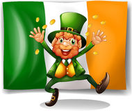 Leprechaun with golden coins by the flag Stock Photo