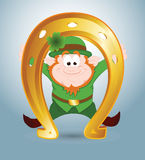 Leprechaun with Golden Horseshoe Royalty Free Stock Images