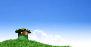 Leprechaun Hat With Gold On A Grassy Hill Royalty Free Stock Photos