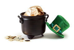 Leprechaun Hat and Pot of Gold. A pot of gold with coins to the side and a Leprechaun hat isolated on white stock image