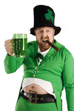 Leprechaun hoisting a green beer Stock Photos