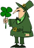 Leprechaun Holding A Four Leaf Clover Royalty Free Stock Photo