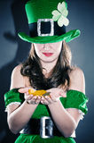 Leprechaun holding gold coins Stock Photos